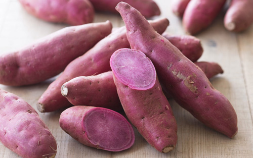 A lovely red-skinned, violet-fleshed Sweet Potato variety.