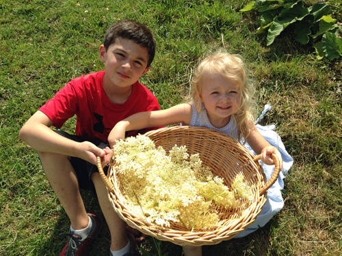 My daughter and nephew with our harvest!